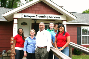 Toney Sellers (middle), president of Unique Clean, poses with some of his staff outside their Marietta office. Pictured from left to right are: Kentara Bernard, administrative assistant; Ellen Pine, contract administration; Sellers; Christy Eidson, accounting/HR; Dana Beckford, administrative assistant; Marie Sherard, contract administration.