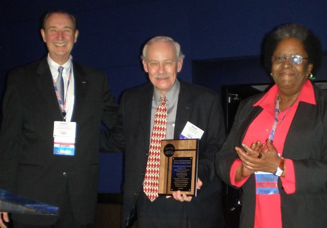 Chuck Schadl (center) accepts award on behalf of GTPAC from APTAC's immediate past president Gunnar Schalin and new president Juanita Beauford.