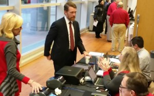 Mark Teskey, small business director for the U.S. Air Force is seen here at the registration desk.