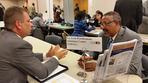 Vendors received one-on-one help from GTPAC counselors like Steve Bettner (l) seen here.